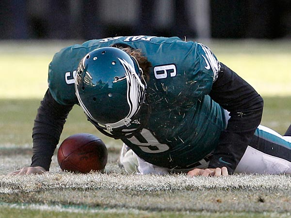 The Eagles&acute; Nick Foles picks himself off the turf after getting sacked<br />against the Washington Redskins on Sunday, December 23, 2012. (Yong Kim/Staff Photographer)