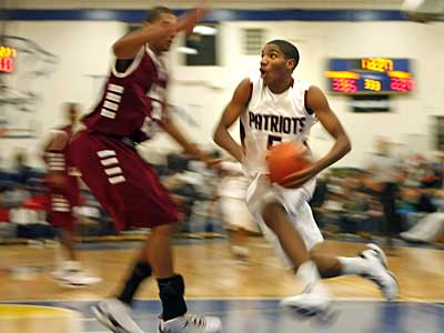 Penn Wood´s Dequan Pelzer drives on Academy of the New Church´s Shane Randall. ( Ron Cortes / Staff Photographer )