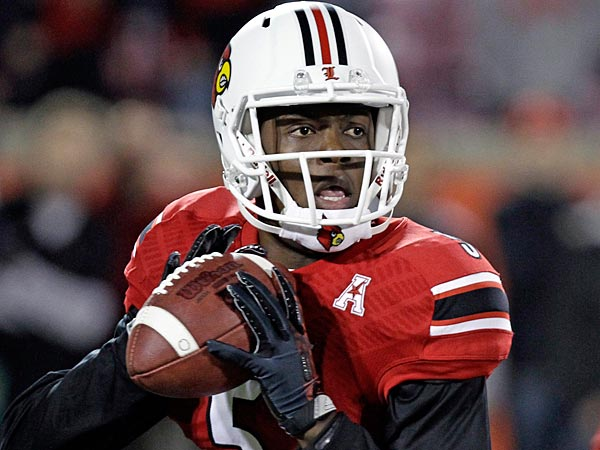 Louisville quarterback Teddy Bridgewater looks to pass. (AP Photo/Garry Jones)