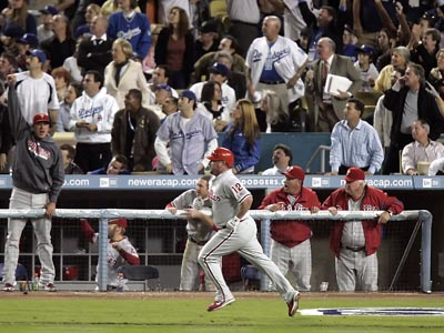 The Phillies bench reacts to Matt Stairs homerun in the eight inning of Game 4 of the NLCS on October 13, 2008. (Michael Perez/Staff file photo)
