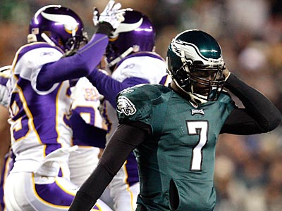 Michael Vick walks off the field after he fumbled the ball as the Vikings celebrate. (David Maialetti / Staff Photographer)