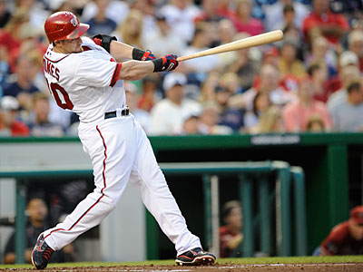 The Phillies could go after Jonny Gomes to provide a right-handed bat off the bench. (Nick Wass/AP Photo)