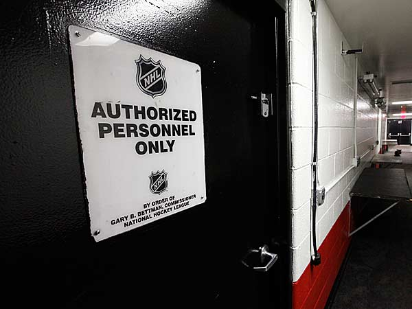 In this photo taken Tuesday, Dec. 18, 2012, an NHL sign for authorized personnel only is shown in an empty hallway at Joe Louis Arena home of the Detroit Red Wings hockey club in Detroit. (Paul Sancya/ AP File)