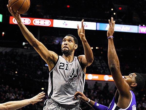 Spurs forward Tim Duncan shoots against Kings forward Jason Thompson. (Darren Abate/AP)