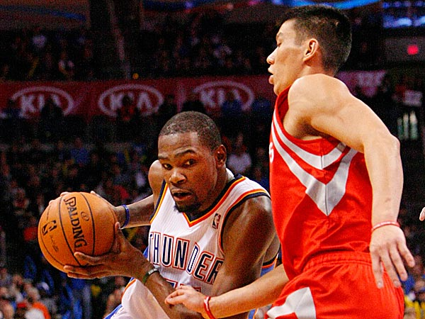 Thunder forward Kevin Durant drives to the basket around Rockets guard Jeremy Lin. (Alonzo Adams/AP)