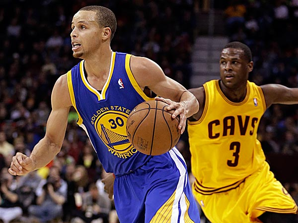 The Warriors´ Stephen Curry drives around the Cavaliers´ Dion Waiters. (Tony Dejak/AP)