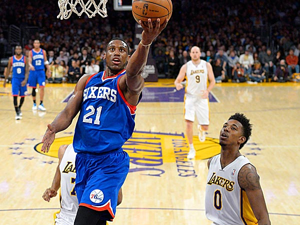 76ers forward Thaddeus Young puts up a shot as Lakers forward Nick Young defends. (Mark J. Terrill/AP)