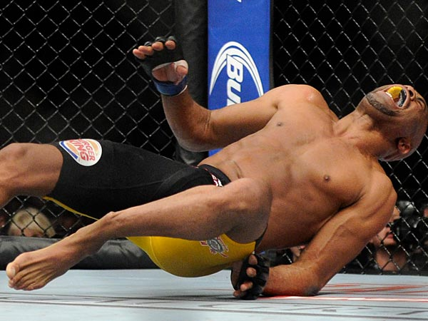 Anderson Silva screams after kicking Chris Weidman and injuring his foot during the UFC 168 mixed martial arts middleweight championship bout on Saturday. (AP Photo/David Becker)