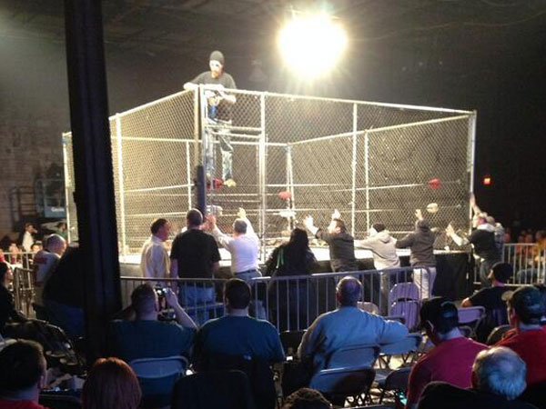 The steel cage being set up for the main event. (Vaughn Johnson/Staff)