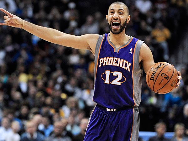 Phoenix Suns guard Kendall Marshall calls out a play in the second half of an NBA basketball game against the Denver Nuggets on Wednesday, April 17, 2013, in Denver. The Nuggets won 118-98. (AP Photo/Chris Schneider)
