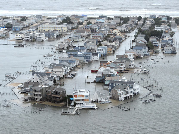 Portion of West 27th Street in Ship Bottom, N.J., on Long Beach Island is underwater Tuesday, Oct. 30, 2012, a day after Hurricane Sandy blew across the New Jersey barrier islands. ( CLEM MURRAY / Staff Photographer )