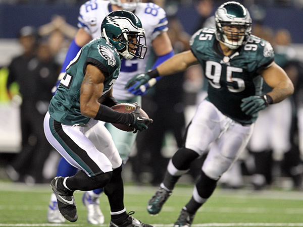 Eagles cornerback Brandon Boykin runs with the ball after intercepting Cowboys quarterback Kyle Orton. (Yong Kim/Staff Photographer)