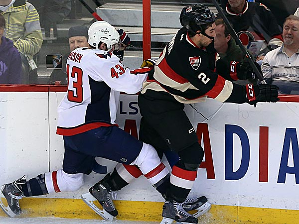 The Senators´ Jared Cowan is checked by the Capitals´ Tom Wilson. (Fred Chartrand/The Canadian Press/AP)