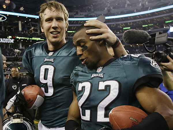 Nick Foles and Brandon Boykin leave the field after the Eagles beat the Cowboys in the regular-season finale last year. (Tony Gutierrez/AP)