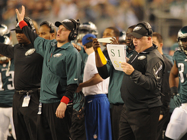 Eagles coach Chip Kelly and his staff call out plays as the Birds take on the Cowboys on Sunday, December 29, 2013. (Clem Murray/Staff Photographer)