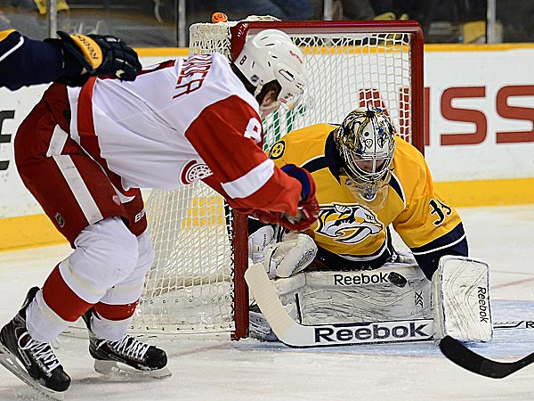 Red Wings left wing Justin Abdelkader flips the puck past Predators goalie Marek Mazanec. (Mark Zaleski/AP)