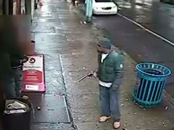 "A man armed with an extremely long-barrelled gun approached and demanded the duo give up their property, saying, ""empty your pockets,"" according to police. The gunman can be seen on video waving around the black revolver rather nonchalantly as several cars whiz by. (Courtesy of Philadelphia Police Department)"