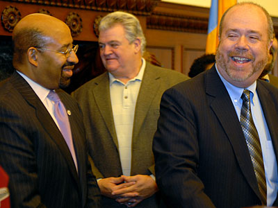 George Badey (right) with Save the Mummers with Mayor Michael Nutter (left) and U.S. Rep. Bob Brady, announcing that the city and Mummers had reached a deal for the annual New Year´s Day parade. (Tom Gralish / Staff Photographer)