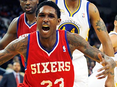 Lou Williams and the Sixers are 9-3 through their first 12 games. (George Nikitin/AP)