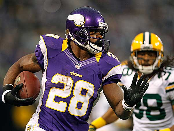 Vikings running back Adrian Peterson was the common denominator in countless fantasy championships. (Genevieve Ross/AP)