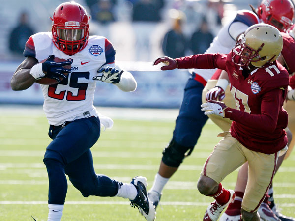 Arizona running back Ka´Deem Carey (25) runs around Boston College defensive back Bryce Jones (17) during the second half of the AdvoCare V100 Bowl NCAA college football game, Tuesday, Dec. 31, 2013, at Independence Stadium in Shreveport, La. Arizona won 42-19. (Rogelio V. Solis/AP)