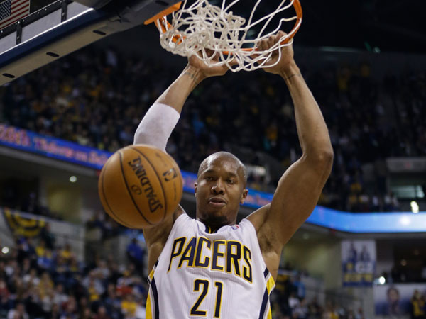 The Pacers´ David West dunks during the second half of an NBA basketball game against the Cleveland Cavaliers on Tuesday, Dec. 31, 2013, in Indianapolis. Indiana defeated Cleveland 91-76. (Darron Cummings/AP)