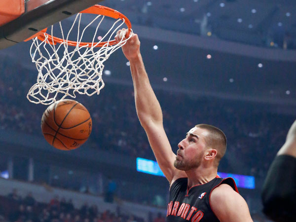 Raptors center Jonas Valanciunas dunks over Chicago Bulls forward Carlos Boozer (5) during the first half of an NBA basketball game Tuesday, Dec. 31, 2013, in Chicago. (Charles Rex Arbogast/AP)