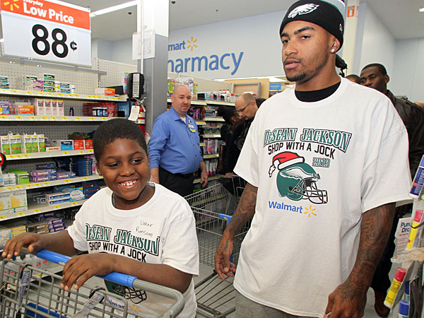 Eagles&acute; DeSean Jackson and Umar Ransom prepare to shop during a<br />shopping spree for under privilege kids at the Walmart on South<br />Christopher Columbus Blvd on Tuesday, December 3, 2013.  (Yong Kim/Staff Photographer)