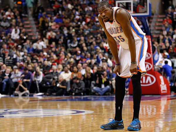 Kevin Durant looks on with his hands on his knees during the first half. (AP Photo/Chris Szagola)