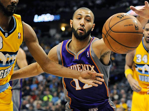Denver Nuggets forward Corey Brewer, left, and Phoenix Suns guard Kendall Marshall, right, fight for a loose ball in the first quarter of an NBA basketball game on Wednesday, April 17, 2013, in Denver. (AP Photo/Chris Schneider)
