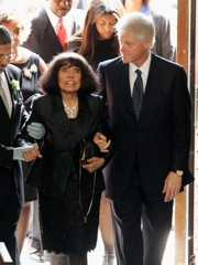 FILE - In this Aug. 15, 2005 file photo, former President Bill Clinton escorts Eunice Johnson, wife of Ebony magazine founder John Johnson, into the Rockefeller Memorial Chapel in Chicago for her husband´s funeral. On Sunday, Jan. 3, 2010, Eunice Johnson died according to the Chicago-based Johnson Publishing Company. She was 93. The cause of death was not immediately available. Eunice Johnson is credited with naming Ebony magazine. Her daughter, Linda Johnson Rice, now heads the publishing company. (AP Photo/Jeff Roberson, File)