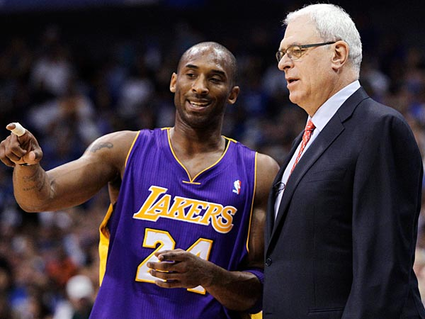 Los Angeles Lakers´ Kobe Bryant and coach Phil Jackson talk during a break against the Dallas Mavericks during the first half of Game 4 of a second-round NBA playoff basketball series, Sunday, May 8, 2011, in Dallas. (AP Photo/Tony Gutierrez)