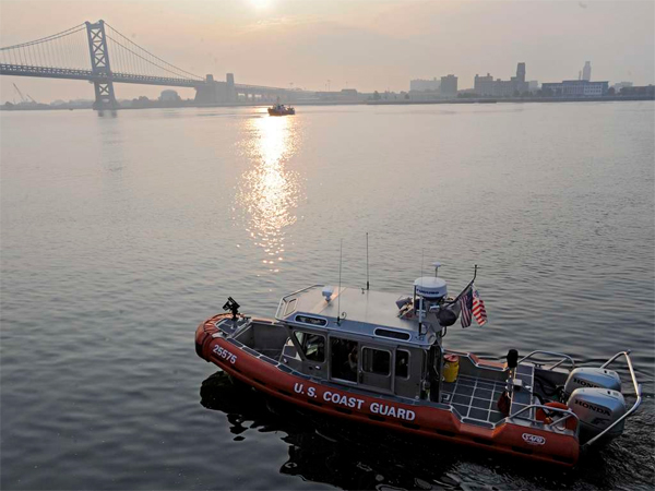 A Coast Guard boat cruises the Delaware. Researchers found intersex fish in the Delaware and two other Pennsylvania rivers.