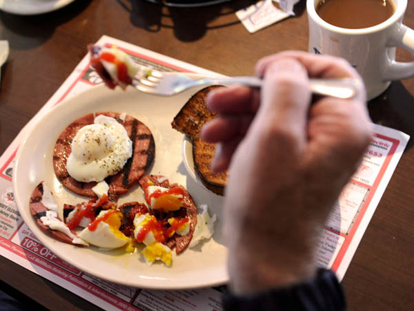 Dick Wagner, 78, now living in Palm Beach Gardens, Fla. eats his breakfast of Taylor Pork Rolls with egg, at the Varsity Inn in Ocean City May 10, 2014. He first came to Ocean City as a three month-old visiting his grandfather. ( TOM GRALISH / Staff Photographer )