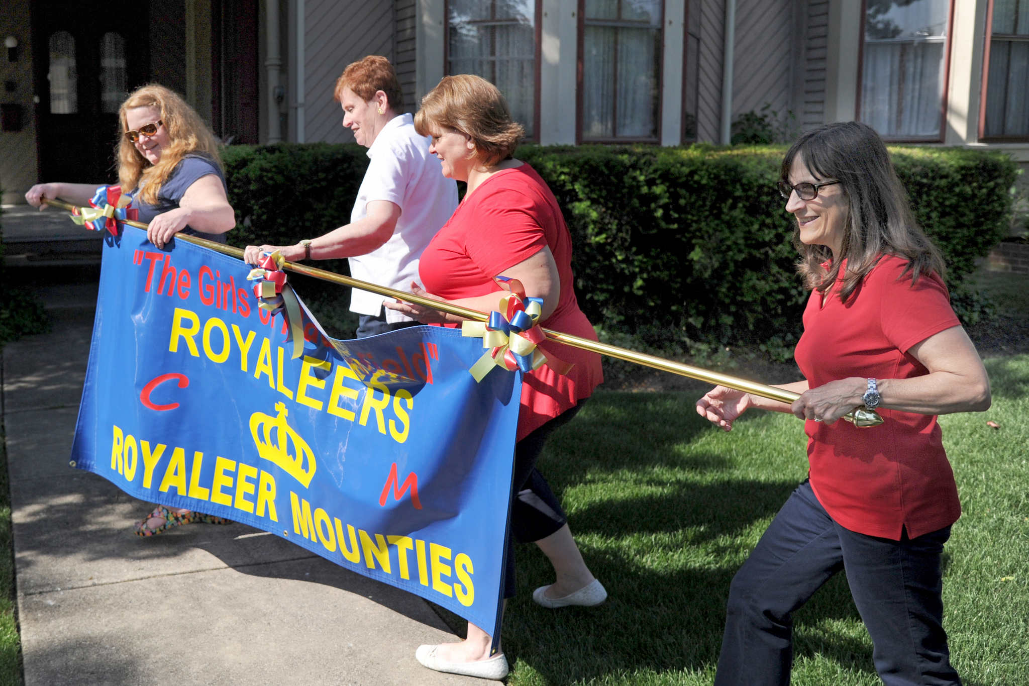 From left, former Royaleers Edwina Kwoka, Maureen McLoone, Pat Thompson, and Terri Brennan with the new banner they will carry when the group reunites for Haddonfield´s Memorial Day Parade.