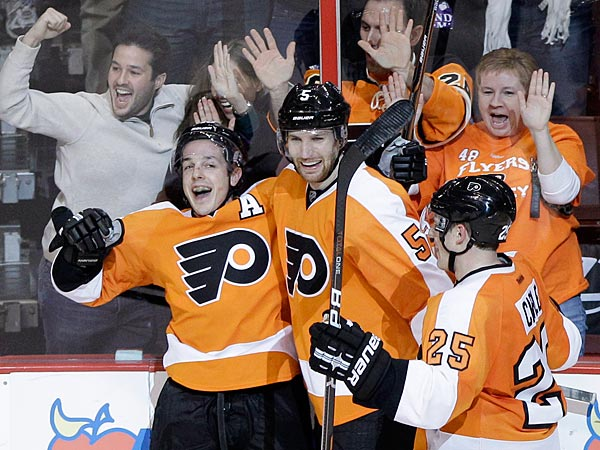 Philadelphia Flyers players, from left, Danny Briere, Braydon Coburn<br />and Matt Carle celebrate Briere&acute;s game-winning goal for a hat trick in<br />overtime of an NHL hockey game against the Ottawa Senators, Saturday, Jan. 7, 2012, in Philadelphia. Philadelphia won 3-2. (AP Photo/Matt Slocum)