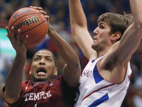 Temple guard Khalif Wyatt (1) shoots while covered by Kansas center<br />Jeff Withey (5) during the second half of an NCAA college basketball<br />game in Lawrence, Kan., Sunday, Jan. 6, 2013. Kansas defeated Temple<br />69-62. (AP Photo/Orlin Wagner)