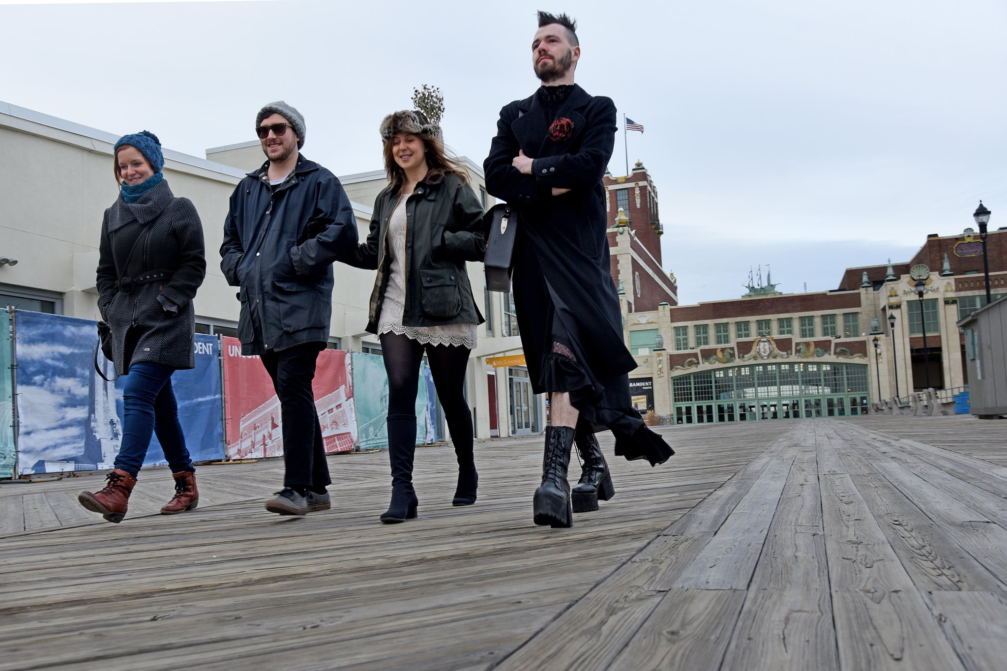 Into music, friend visit Asbury Park (from left) Britta Potesil, from Cologne, Germany; Ian Gray, South Philadelphia; Jessie Lipskin, Ocean Grove; and David Ross Lawn, Ocean Grove. They are walking along the Boardwalk with Convention Hall and the Paramount Theatre in background.