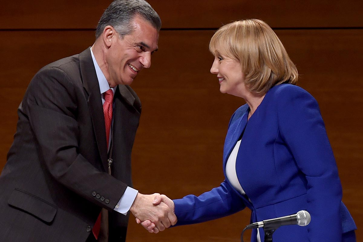 Assemblyman Jack Ciattarelli and Lt. Gov. Kim Guadagno, Republicans running to succeed New Jersey Gov. Christie, will debate Thursday in Newark. Here, they are shaking hands at their first matchup, May 9 at Stockton University.