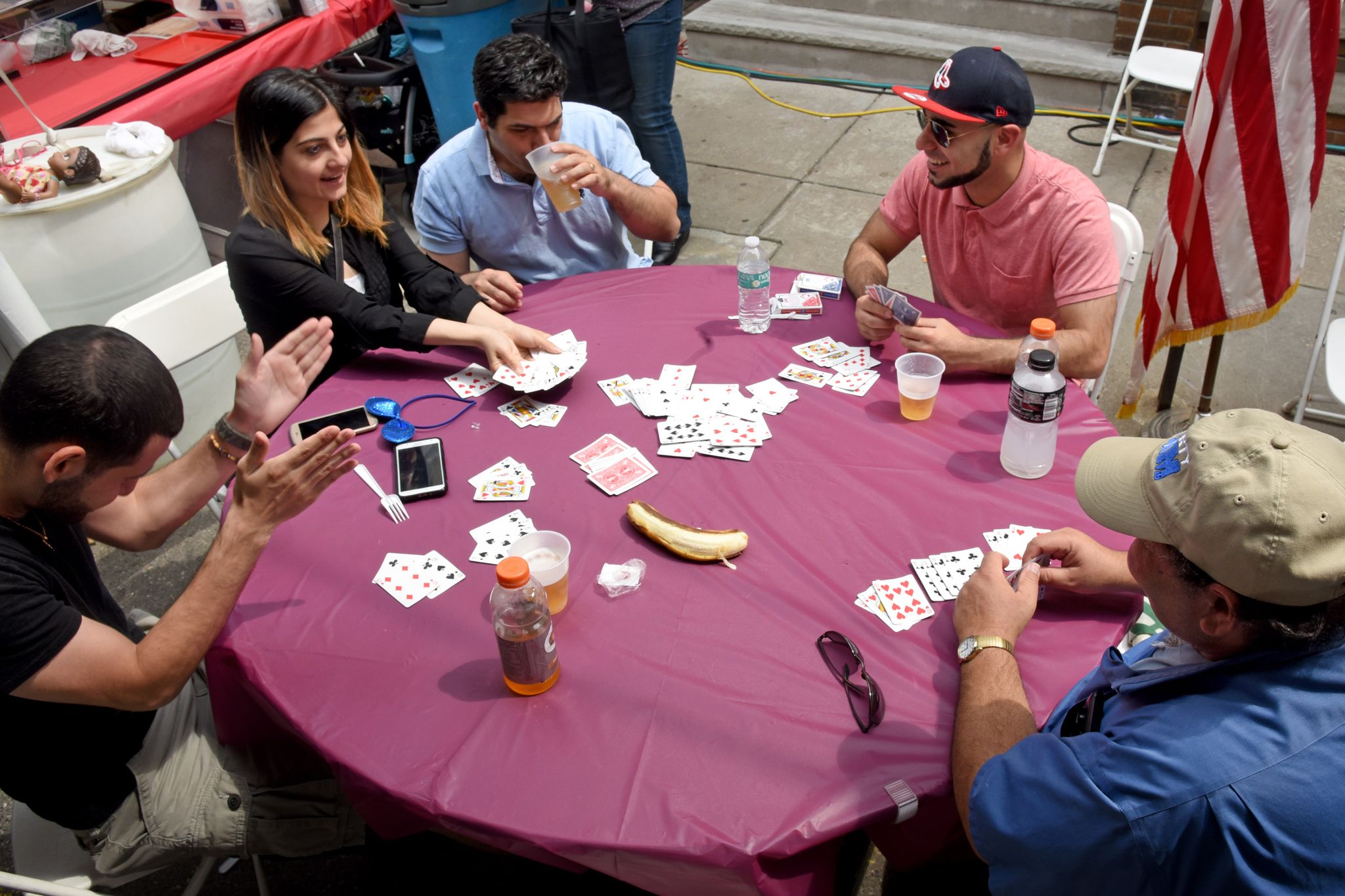Louis Al-Shouli (left) celebrates his victory in a rummy game of Kalooki 51 with his cousins, all from South Philadelphia, Maryam Takfoor (from left), Tony Takfoor, Chris Sholy, and Anwar Muaddi.