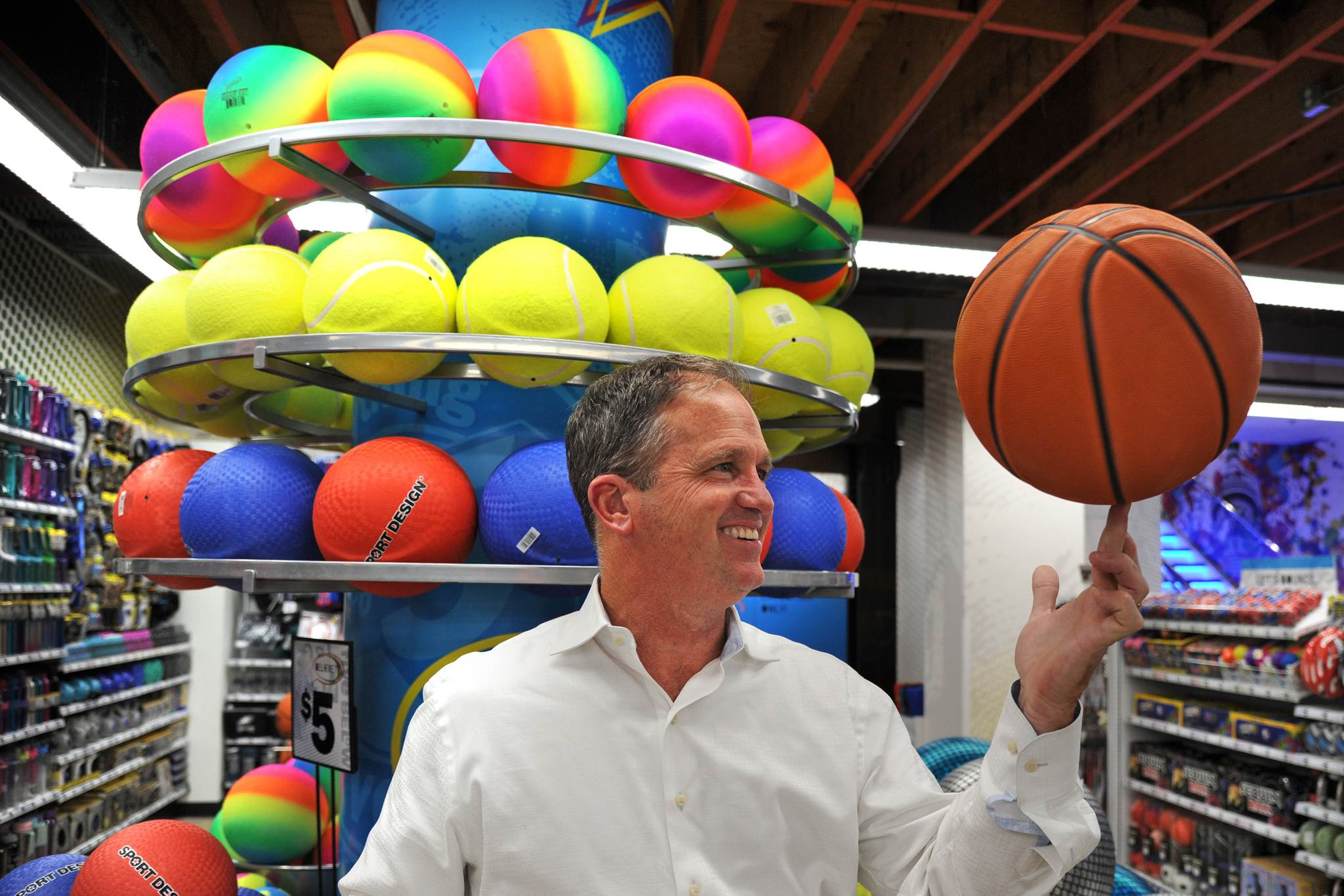 Five Below CEO Joel Anderson spins a basketball at their newest store in the historic Lits Building on East Market Street.