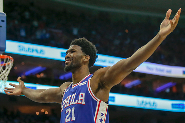Sixers center Joel Embiid celebrates after getting fouled and making the basket against the Utah Jazz during the fourth-quarter on Monday, November 20, 2017 in Philadelphia.  YONG KIM / Staff Photographer.  YONG KIM / Staff Photographer