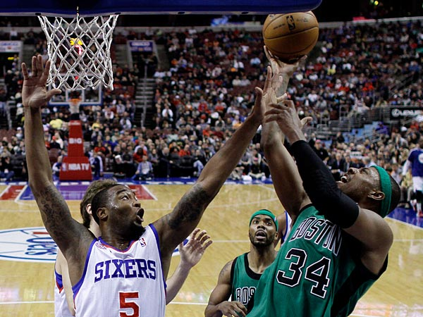 Boston Celtics´ Paul Pierce, right, goes up for a shot as Philadelphia 76ers´ Arnett Moultrie defends in the first half of an NBA basketball game, Friday, Dec. 7, 2012, in Philadelphia. (AP Photo/Matt Slocum)