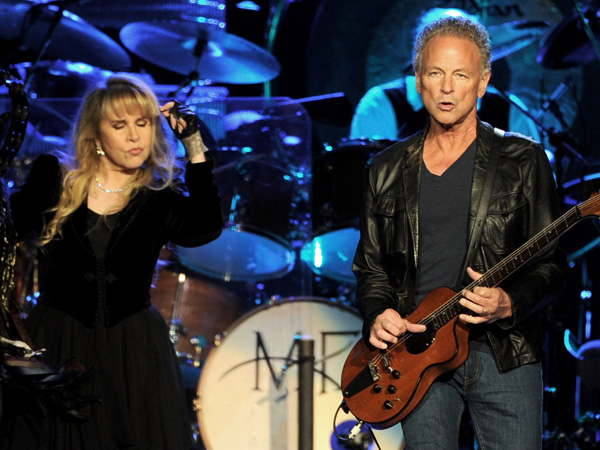 Singer Stevie Nicks (L) and musician Lindsey Buckingham of Fleetwood Mac perform at The Staples Center on July 3, 2013 in Los Angeles, California.  (Photo by Kevin Winter/Getty Images)