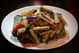 The Asian eggplant, wok-fried and flavored with belacan, tastes like Malaysian french fries.                                      DAVID SWANSON/Inquirer