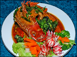 The fried whole red snapper, showered in spicy garlic sauce, is an impressive dish.                                      (John Costello/Inquirer)