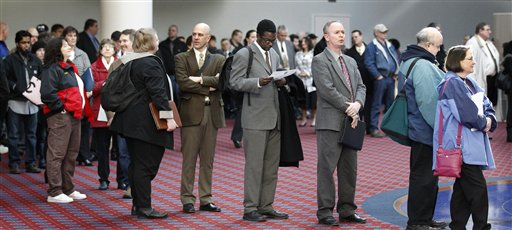 FILE - In this March 7, 2012, file photo shows job seekers standing line during the Career Expo job fair, in Portland, Ore.  Employers pulled back sharply on hiring last month, a reminder that the U.S. economy may not be growing fast enough to sustain robust job growth. The unemployment rate dipped, but mostly because more Americans stopped looking for work.  The Labor Department says the economy added 120,000 jobs in March, down from more than 200,000 in each of the previous three months. (AP Photo/Rick Bowmer)<br />