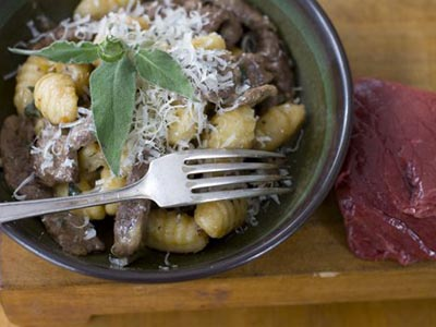 In this image taken on Feb. 27, 2012, bison with sage and gnocchi is shown in Concord, N.H. (AP Photo/Matthew Mead)