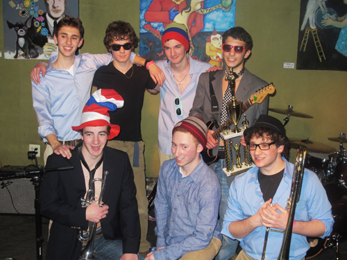 (Courtesy Lauren Fox) Poor Fred Noonan formed not long before auditions for the Battle of the Burbs. Front row from left to right: Matt Brown, trumpet, Harriton junior; Jeremy Levick, bass, Harriton senior;  Ilias Storti, trombone, Harriton senior. Back row, left to right: Jordan Rosenthal-Kay, guitar, Harriton junior; Christian Turzo-Egan, drums, St. Joe´s Prep junior; Jake Marks, saxophone, Harriton junior; Dylan Pearl, vocals & guitar, Harriton junior.