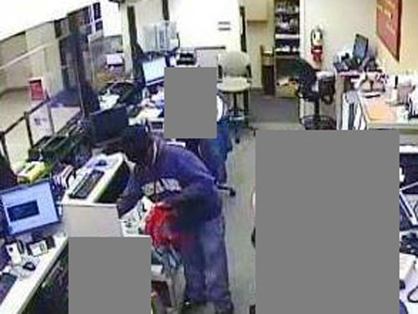 Surveillance camera picture of bank robbery at Wells Fargo Bank in Langhorne on Feb. 21, 2014.